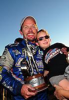 Oct. 16, 2011; Chandler, AZ, USA; NHRA funny car driver Jack Beckman celebrates with his son Jason Beckman after winning the Arizona Nationals at Firebird International Raceway. Mandatory Credit: Mark J. Rebilas-