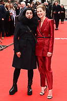 "Marjane Satrapi and Rosamund Pike<br /> arriving for the ""Radioactive"" premiere at the Curzon Mayfair, London.<br /> <br /> ©Ash Knotek  D3560 07/03/2020"