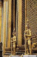 Statues and glittering columns of The Royal Pantheon or Prasat Phra Dhepbidorn, Wat Phra Kaeo, Bangkok, Thailand