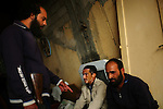 Sirte, LIBYA: Monday 11th October 2011:..Suspected Gaddafi loyalist soldiers are questioned by a rebel fighter in a captured house in Sirte. ..Ayman Oghanna