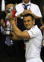 PICTURE BY VAUGHN RIDLEY/SWPIX.COM - Rugby League - 2013 International Origin - England v Exiles - Halliwell Jones Stadium, Warrington, England - 14/06/13 - England Captain Kevin Sinfield lifts the International Origin Trophy.