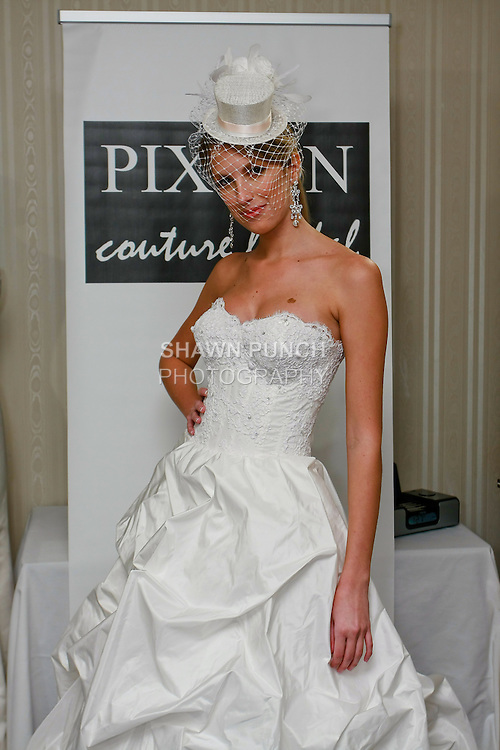 Model poses in an Isabella wedding dress by Kimberly Pixton Millar, for the Pixton Couture Bridal Spring 2011 presentation during the WeddingChannel Couture Show, October 18, 2010.