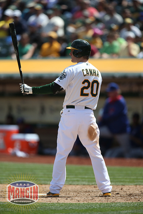 OAKLAND, CA - APRIL 9:  Mark Canha #20 of the Oakland Athletics bats against the Texas Rangers during the game at O.co Coliseum on Thursday, April 9, 2015 in Oakland, California. Photo by Brad Mangin