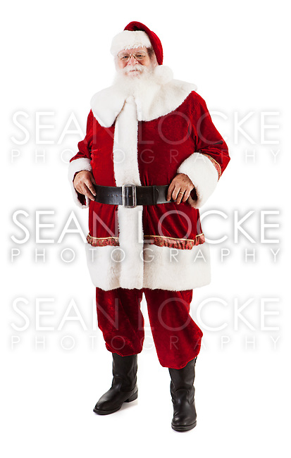 Traditional style authentic Santa Claus with real beard and handmade suit.  Isolated on white for Christmas.