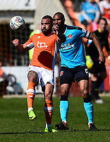 Blackpool's Kyle Vassell competes with Fleetwood Town's Nathan Pond<br /> <br /> Photographer Richard Martin-Roberts/CameraSport<br /> <br /> The EFL Sky Bet League One - Blackpool v Fleetwood Town - Saturday 14th April 2018 - Bloomfield Road - Blackpool<br /> <br /> World Copyright &not;&copy; 2018 CameraSport. All rights reserved. 43 Linden Ave. Countesthorpe. Leicester. England. LE8 5PG - Tel: +44 (0) 116 277 4147 - admin@camerasport.com - www.camerasport.com