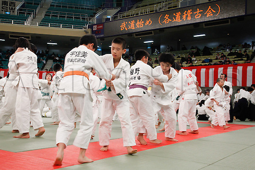 10.01.2011 Tokyo, Japan - Hundreds practitioners participate new years first training of various forms of traditional Japanese martial arts during a traditional Kagami-biraki ceremony at Tokyos Budokan Martial Arts Hall. The tradition of Kagami-biraki was originated in 15th century among samurais to officially start the first workout of the new year.