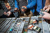 In between rounds, players gathered around vendor booths to buy, sell, and trade cards. While some aim to create powerful decks for game play, others are in it for the collectibles. <br /> <br /> Danny Ghitis for Bloomberg Businessweek
