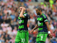 Gylfi Sigurosson of Swansea City (left) and Ashley Williams of Swansea City looks dejected after conceding a goal during the Barclays Premier League match between Sunderland and Swansea City played at Stadium of Light, Sunderland