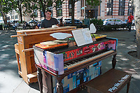 New York, NY -  2 July 2010 - Play Me I'm Yours. Back to back pianos in TriBeCa Park.