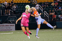 Western New York Flash defender Abigail Dahlkemper (13) and Houston Dash forward Rachel Daly (3) collide during recent NWSL match.