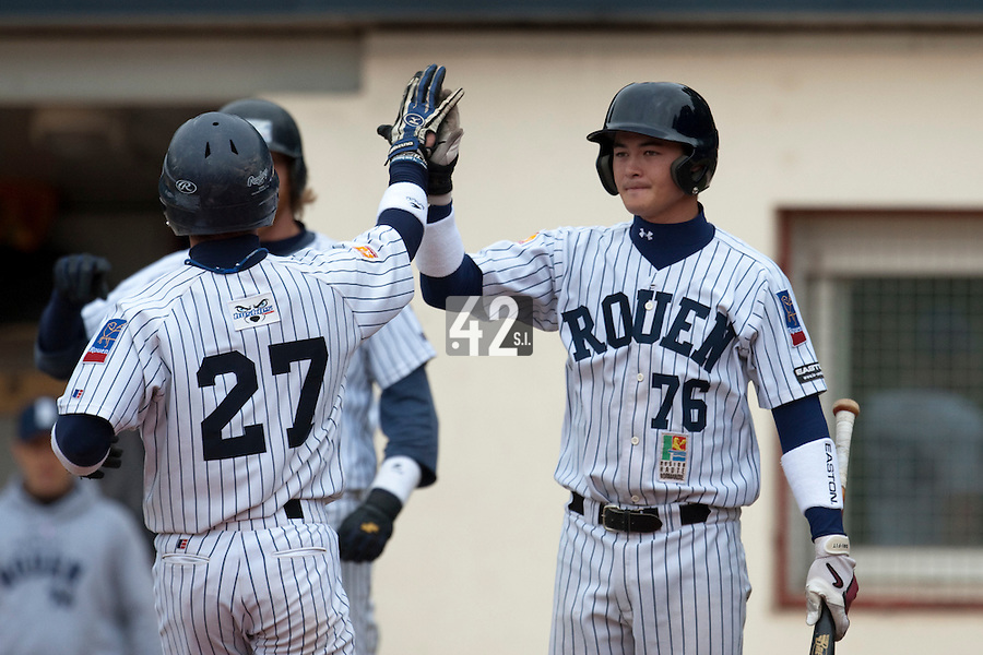 03 october 2009: Kenji Hagiwara of Rouen congratulates Joris Bert during game 1 of the 2009 French Elite Finals won 6-5 by Rouen over Savigny in the 11th inning, at Stade Pierre Rolland stadium in Rouen, France.