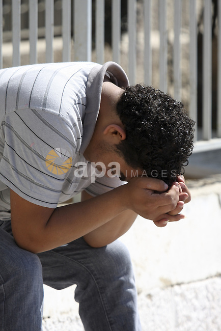 A Palestinian general secondary student sits sad after he failed in the exams results in the West Bank city of Ramallah on July 22, 2010. Photo by Eyad Jadallah