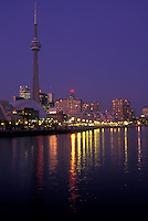AJ0831, Canada, Ontario, Toronto, Skyline of downtown Toronto and CN Tower reflect in the waters of Lake Ontario in the evening.