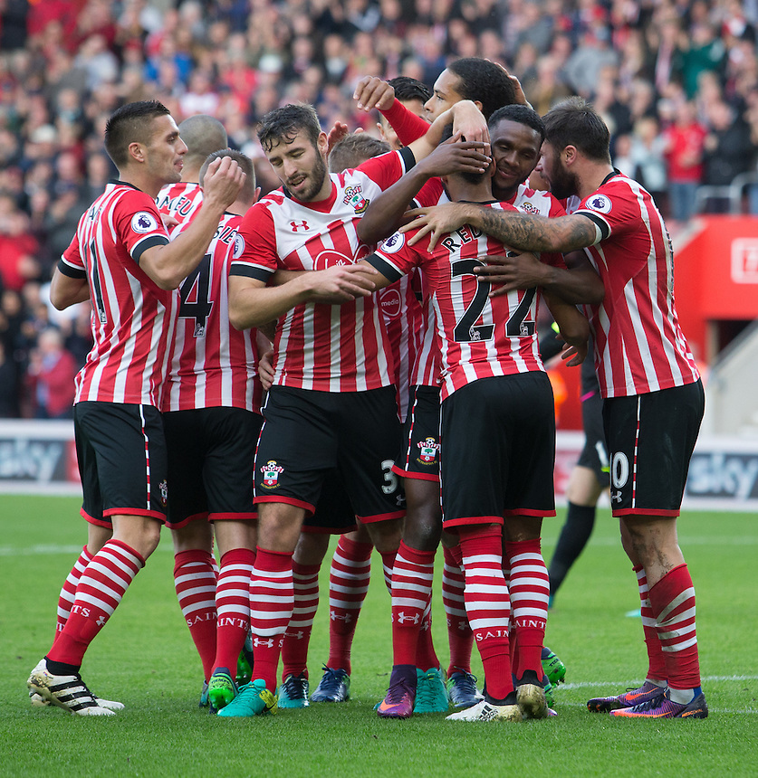 Southampton's Nathan Redmond is mobbed by team mates after scoring Southamptons second goal<br /> <br /> Photographer James Williamson/CameraSport<br /> <br /> The Premier League - Southampton v Burnley - Sunday 16th October 2016 - St Mary's Stadium - Southampton<br /> <br /> World Copyright &copy; 2016 CameraSport. All rights reserved. 43 Linden Ave. Countesthorpe. Leicester. England. LE8 5PG - Tel: +44 (0) 116 277 4147 - admin@camerasport.com - www.camerasport.com
