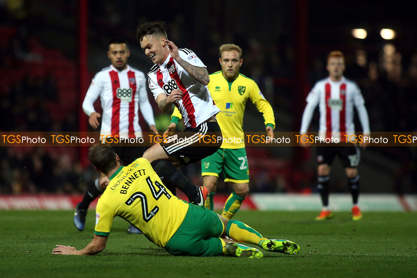 Ryan Bennett of Norwich sends Brentford's Josh McEachran flying after a strong challenge during Brentford vs Norwich City, Sky Bet EFL Championship Football at Griffin Park on 31st December 2016
