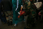 Sirte, LIBYA: Monday 11th October 2011:..A wounded rebel soldier is taken to an ambulance. Military gains came at a heavy price, with medics reporting 13 dead and 90 wounded on the western side of Sirte alone..Ayman Oghanna