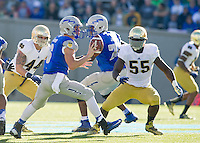 Air Force Falcons quarterback Nate Romine (6) pitches the ball as linebacker Carlo Calabrese (44) and linebacker Prince Shembo (55) defend.