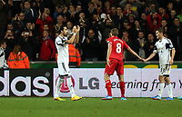 Pictured: (L-R) Chico Flores, Steven Gerrard, Ben Davies.<br /> Monday 16 September 2013<br /> Re: Barclay's Premier League, Swansea City FC v Liverpool at the Liberty Stadium, south Wales.