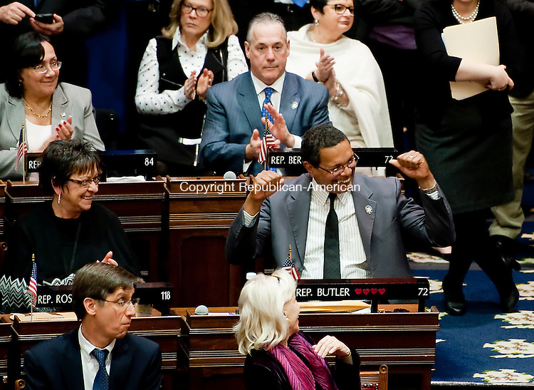 HARTFORD,  CT-010715JS11-Rep. Larry B. Butler, D-72nd District, cheers the governor's promise to fund a long-term transportation vision,  during the Governor's State of the State Address during a joint session of the Connecticut General Assembly in the Hall of the House of Representatives Wednesday at the State Capitol in Hartford. <br />  Jim Shannon Republican-American