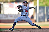 Rome Braves starting pitcher Yean Carlos Gil #46 delivers a pitch during a game against the Asheville Tourists at McCormick Field on May 1, 2014 in Asheville, North Carolina. The Tourists defeated the Braves 8-7. (Tony Farlow/Four Seam Images)