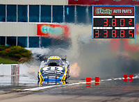 May 20, 2017; Topeka, KS, USA; (Composite image with scoreboard) NHRA funny car driver Matt Hagan runs a 3.802 elapsed time at 338.85 mph for the quickest and fastest run in history during qualifying for the Heartland Nationals at Heartland Park Topeka. Mandatory Credit: Mark J. Rebilas-USA TODAY Sports