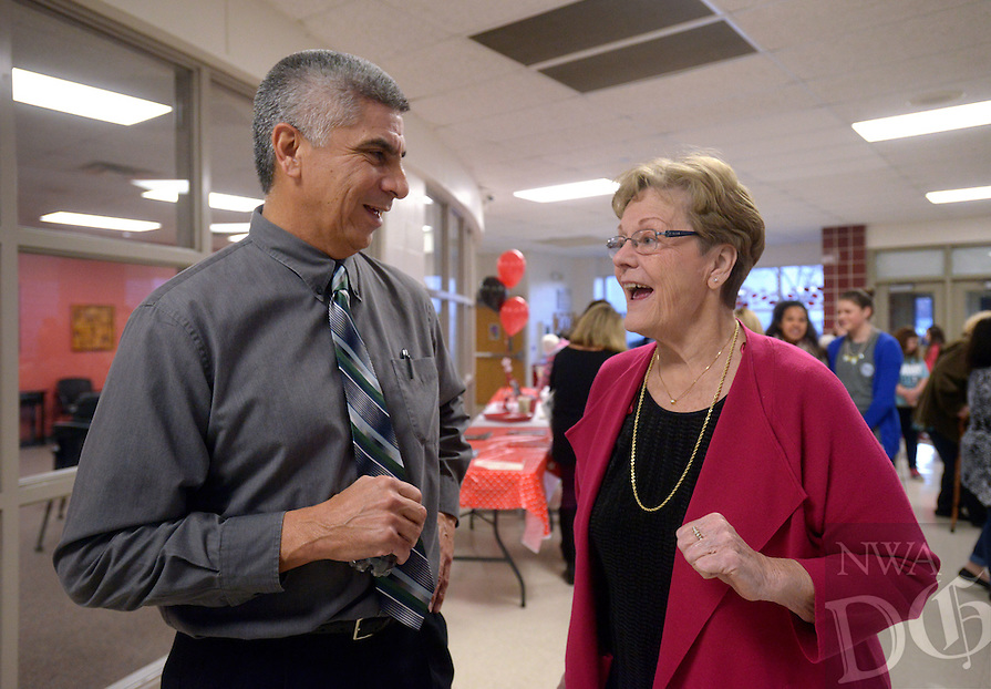 NWA Democrat-Gazette/BEN GOFF @NWABENGOFF<br /> Denny Higgins (right), the first principal of Greer Lingle Middle Scoool, talks with Larry Ben, who was one of her assistant principals and is now superintendent of Greenalan Public Schools, on Monday Jan. 16, 2017 during a 20th anniversary celebration at the school in Rogers. The school opened with just 6th grade in the fall of 1996, with 7th graders arriving in Jan. of 1997. Since Aug. 2008 the school has also had 8th grade.