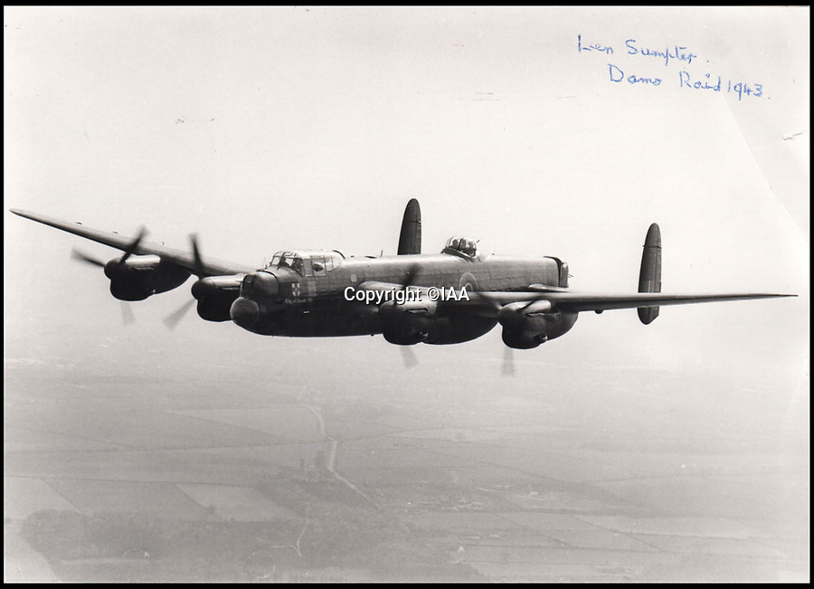 BNPS.co.uk (01202 558833)<br /> Pic: IAA/BNPS<br /> <br /> Photograph by Sumpter, the image depicting a bomber aircraft in flight.<br /> <br /> This poignant piece of paper charting the fate of the 19 Dambusters' crews highlights the cruel and random nature of the famous World War Two raid. <br /> <br /> Flight Sergeant Leonard Sumpter got hold of a typed list of all the RAF bombers involved in Operation Chastise and ticked off the unfortunate crews which didn't make it back.<br /> <br /> Of the 19 Lancaster bombers, eight were shot down resulting in the deaths of 53 airmen. Two others had to return to England after developing faults.<br /> <br /> The crew list has now emerged for sale for £800.