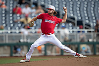 Louisville Cardinals pitcher Adam Elliott (4) delivers a pitch to the plate during Game 7 of the NCAA College World Series against the Auburn Tigers on June 18, 2019 at TD Ameritrade Park in Omaha, Nebraska. Louisville defeated Auburn 5-3. (Andrew Woolley/Four Seam Images)