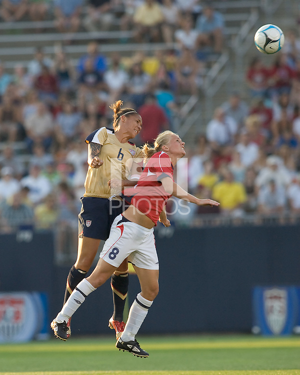 Natasha Kai (United States, gold) and Solveig Gulbrandsen (Norway, red) go for a head ball. The United States defeated Norway, 1-0, in Rentschler Stadium, July 14, 2007.