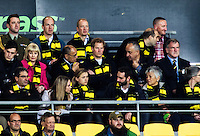 Prince Harry sits with NZ governor-general Sir Jerry Mataparae to his left and Hurricanes chief executive James Te Puni to his left during the Super Rugby match between the Hurricanes and Sharks at Westpac Stadium, Wellington, New Zealand on Saturday, 9 May 2015. Photo: Dave Lintott / lintottphoto.co.nz