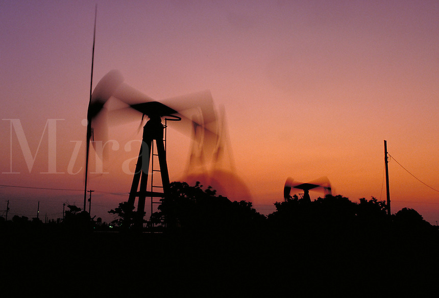 Petroleum industry ; oil ; production ; pumpjack ; domestic ; dusk ; motion ;. Houston Texas.
