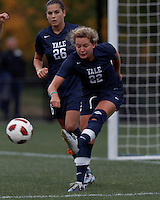 Yale University defender Shannon McSweeney (22) clears the ball. In overtime, Harvard University defeated Yale University,1-0, at Soldiers Field Soccer Stadium, on September 29, 2012.