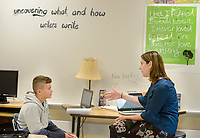 Teacher Michelle Ambrosini works with Dylan Augustine, 12, in her seventh grade English Language Arts class Tuesday, November 07, 2017 at Holing Middle School in Buckingham, Pennsylvania. Ambrosini has been named Teacher of the Year by the Veterans of Foreign Wars Chapter 175 of Doylestown. (Photo by William Thomas Cain)