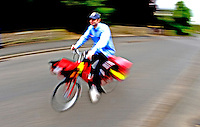 Postman on bike..©shoutpictures.com..john@shoutpictures.com