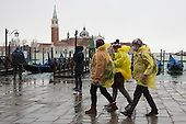 As the annual Carnival celebrations get underway in Venice, high water (acqua alta) floods many parts of the city. Many tourists have been caught out by the high water and had to buy reinforced plastic boots in bright colours - which are worn over normal shoes - to keep dry. Better weather is forecast for the carnival celebrations in St Mark's Square this weekend.