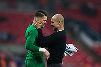 Manchester City manager Josep Guardiola celebrates with Manchester City's Ederson <br /> <br /> Photographer Craig Mercer/CameraSport<br /> <br /> The Premier League - Tottenham Hotspur v Manchester City - Saturday 14th April 2018 - Wembley Stadium - London<br /> <br /> World Copyright &copy; 2018 CameraSport. All rights reserved. 43 Linden Ave. Countesthorpe. Leicester. England. LE8 5PG - Tel: +44 (0) 116 277 4147 - admin@camerasport.com - www.camerasport.com