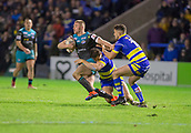 2nd February 2019, Halliwell Jones Stadium, Warrington, England; Betfred Super League rugby, Warrington Wolves versus Leeds Rhinos; Jack Walker is tackled by Jason Clark