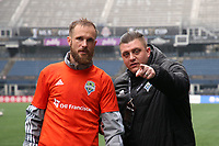 SEATTLE, WA - NOVEMBER 9: Stefan Frei #24 of the Seattle Sounders FC is directed towards the media by press officer Alex Caulfield at CenturyLink Field on November 9, 2019 in Seattle, Washington.