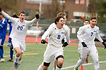 NEW BRITAIN, CT-111817JS07- Lewis Mills' Dylan McCall (8) celebrates his game-winning goal with teammates in their 3-2 win over Suffield to capture the Class M state title Saturday at Willow Brook Park in New Britain.<br /> Jim Shannon Republican-American