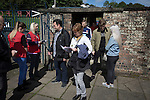 Harestanes AFC v Girvan FC, 15/08/2015. Scottish Cup preliminary round, Duncansfield Park. Spectators buying match programmes before Harestanes AFC take on Girvan FC in a Scottish Cup preliminary round tie, staged at Duncansfield Park, home of Kilsyth Rangers. The home team were the first winners of the Scottish Amateur Cup to be admitted directly into the Scottish Cup in the modern era, whilst the visitors participated as a result of being members of both the Scottish Football Association and the Scottish Junior Football Association. Girvan won the match by 3-0, watched by a crowd of 300, which was moved from Harestanes ground as it did not comply with Scottish Cup standards. Photo by Colin McPherson.