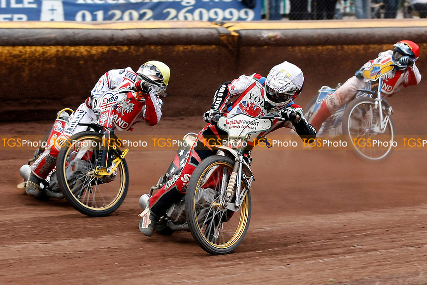 O.Fajfer(yellow),S.Worrall(white) - FIM Speedway Under-21 World Championship Final 1 at Poole Speedway Stadium - 24/07/11 - MANDATORY CREDIT: Rafal Wlosek/TGSPHOTO - Self billing applies where appropriate - 0845 094 6026 - contact@tgsphoto.co.uk - NO UNPAID USE.