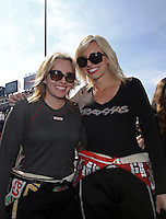 Mar. 17, 2013; Gainesville, FL, USA; NHRA top fuel dragster driver Brittany Force (left) with sister, funny car driver Courtney Force during the Gatornationals at Auto-Plus Raceway at Gainesville. Mandatory Credit: Mark J. Rebilas-