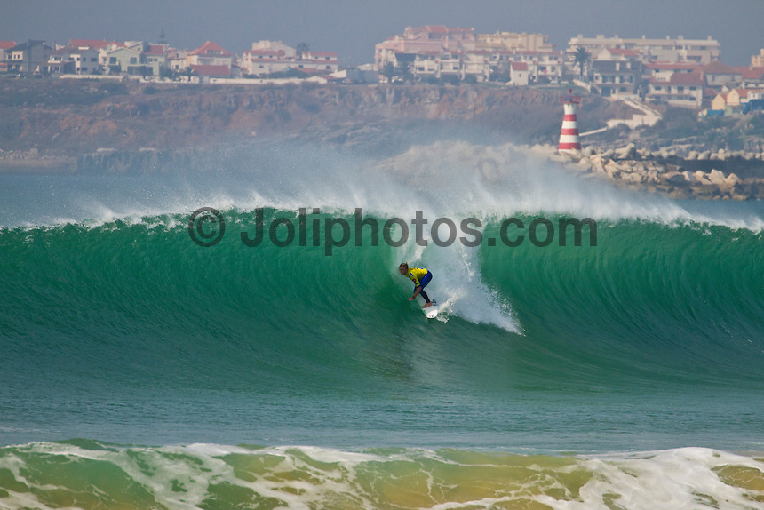 "SUPERTUBOS, Peniche/Portugal (Monday, October 17, 2011) Dusty Payne (HAW) . – The Rip Curl Pro Portugal stormed through 21 heats of competition today as the primary site of Supertubos delivered flawless six-to-eight foot (2 – 2.5 metre) barrels from sun up to sun down.. .Event No. 9 of 11 on the 2011 ASP World Title Series, the Rip Curl Pro Portugal enjoyed an historic day of action with the world's best surfers posting near-perfect scores throughout the day as Supertubos delivered world-class action.. .Julian Wilson (AUS), 22, 2011 ASP Top 34 rookie, went blow-for-blow against compatriot Kai Otton (AUS), 31, in the heat of the event today. Otton posted a near perfect 9.97 out of a possible 10 on his opening ride and backing it up with an excellent 8.43 to put the youngster on the back foot early on. However, Wilson would answer back in champion fashion, netting a 9.43 early in the heat before pulling into a cavernous bomb for a 9.70 and the heat win.. ""That was an amazing heat,"" Wilson said. ""My hat goes off to Otto (Kai Otton) as he was getting some ridiculous barrels and really put the pressure on me early. I've been watching the conditions all day long and have been trying not to froth out too hard, but they're just so perfect. It's truly Dream Tour stuff out there today."" .Bede Durbidge (AUS) scored the contest's first perfect 10 point ride against Mick Fanning (AUS) in the last heat of the day. Durbidge advanced over Fanning to Round Four. Photo: joliphotos.com"