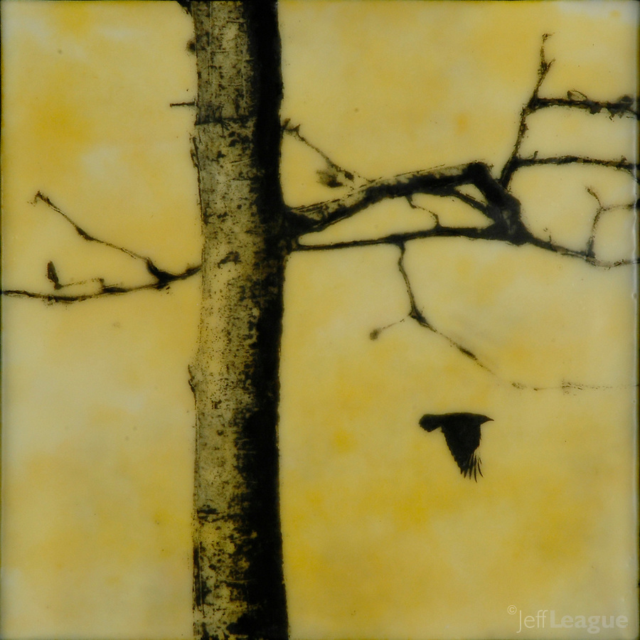Encaustic photography of bare tree with crow in yellow sky
