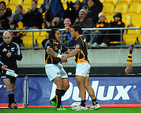 Ma'a Nonu celebrates Alapati Leiua's try as Willie Ripia disappears over the adrvertising hoardings. ITM Cup rugby union - Wellington Lions v Taranaki at Westpac Stadium, Wellington, New Zealand on Saturday, 16 October 2010. Photo: Dave Lintott / lintottphoto.co.nz