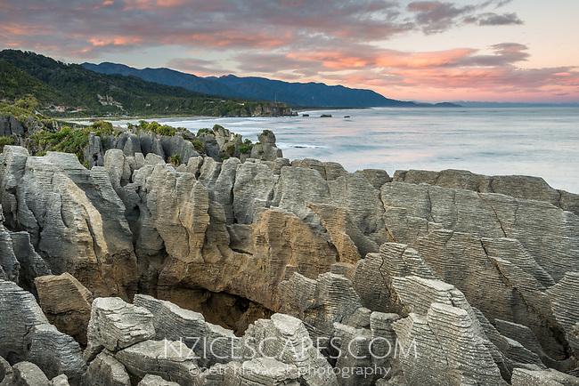Pancake Rocks, limestone formations in Punakaiki at pastel sunrise, Paparoa National Park, Buller Region, West Coast, New Zealand, NZ
