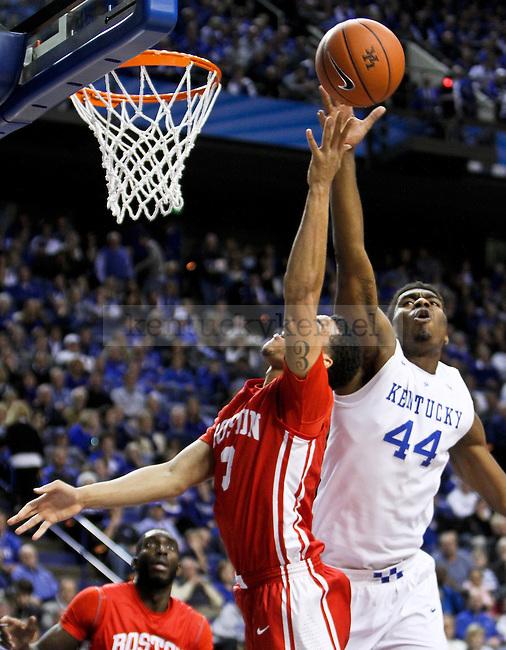 Kentucky center Dakari Johnson blocks a shot during the first half of the UK men's basketball game vs. Boston University Rupp Arena in Lexington , Ky., on Friday, November 21, 2014. Photo by Jonathan Krueger | Staff