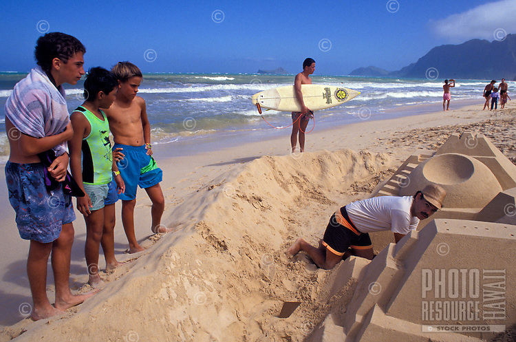 People gathered to watch a sand castle being built on the beach