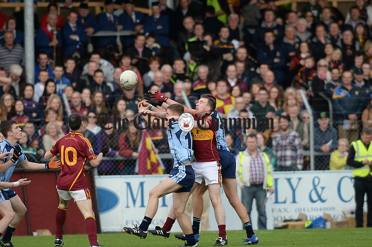 Gearoid Curtin of Miltown in action against Damien Burke and Tadgh Lillis of Cooraclare during the county senior football final at Cusack park. Photograph by John Kelly.