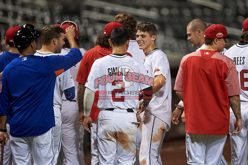 Scottsdale Scorpions Nick Maton (16), of the Philadelphia Phillies organization, is congratulated by teammates after hitting a walk-off home run during an Arizona Fall League game against the Glendale Desert Dogs on September 20, 2019 at Salt River Fields at Talking Stick in Scottsdale, Arizona. Scottsdale defeated Glendale 3-2. (Zachary Lucy/Four Seam Images)